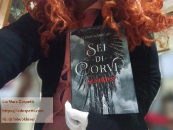 Lia Mara Dospetti holding the Italian copy of Six of Crows by Leigh Bardugo