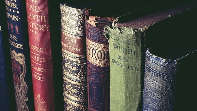 [Image: low light photo of ancient books]
