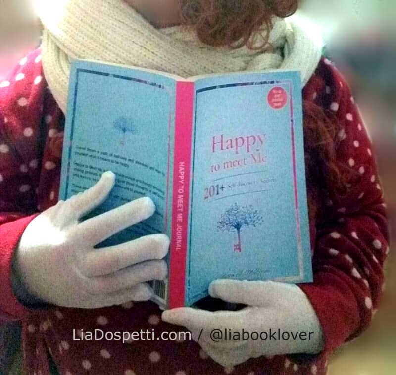 Happy to Meet Me - Book Review - Photo of me holding the print copy of the journal